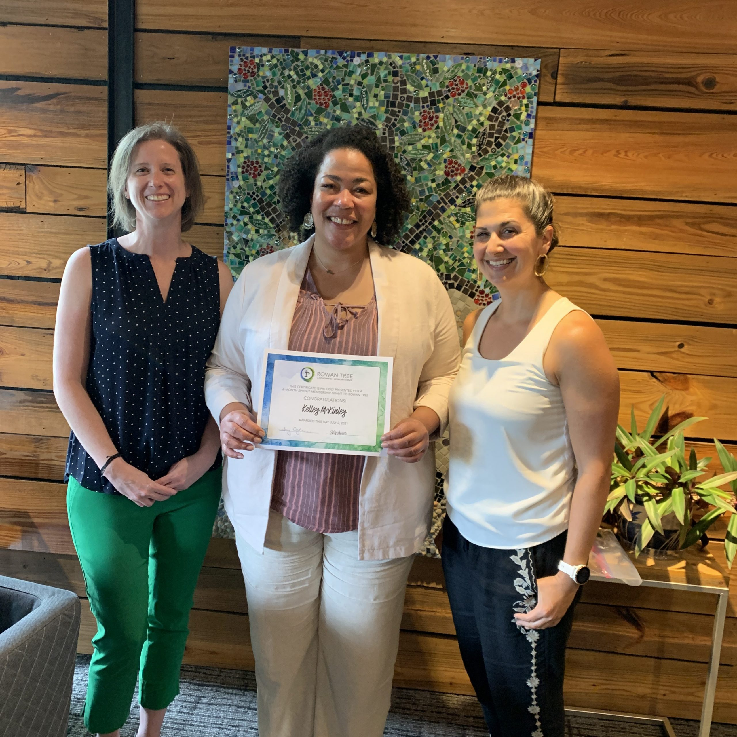 Sprout Membership Grant Winner Kelly McKinley (center) with Co-Founders Amy and Kate